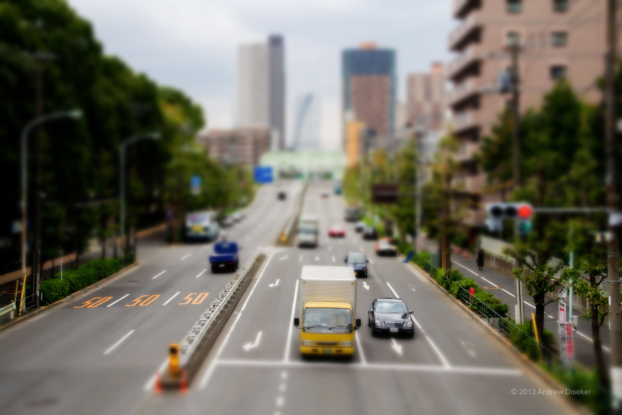 simulated tilt-shift processed photo of cars on highway taken from overhead